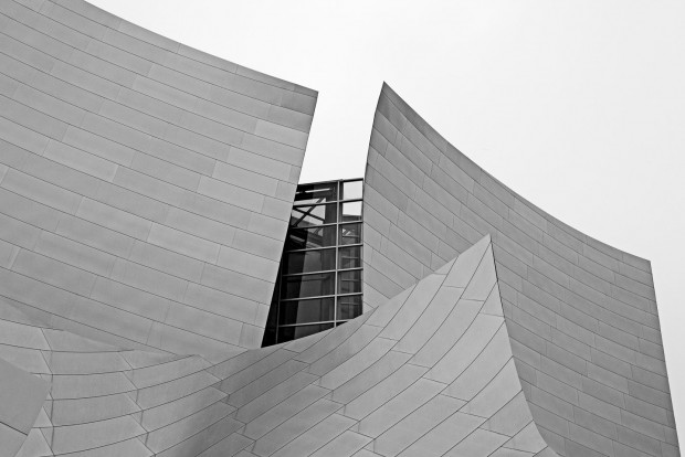 aluminum panels peel away to reveal a high hidden glass window at the Walt Disney Concert Hall, photographed by Jacob Rosenfeld