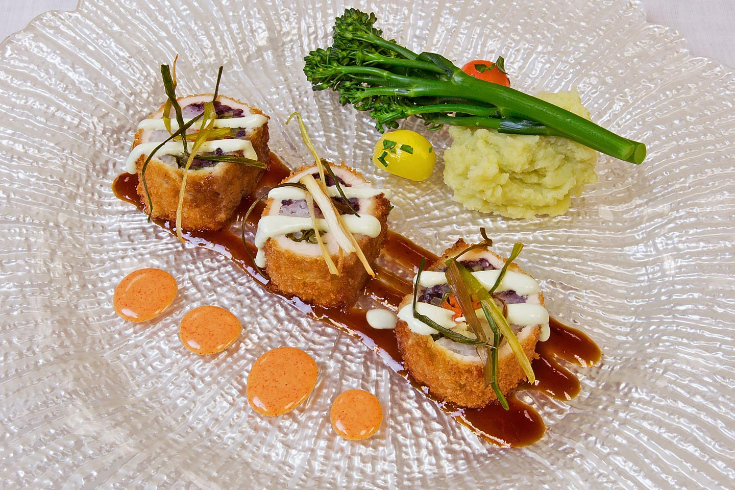an awesome chicken sushi entree with broccolini atop mashed potatoes, photographed by Jacob Rosenfeld