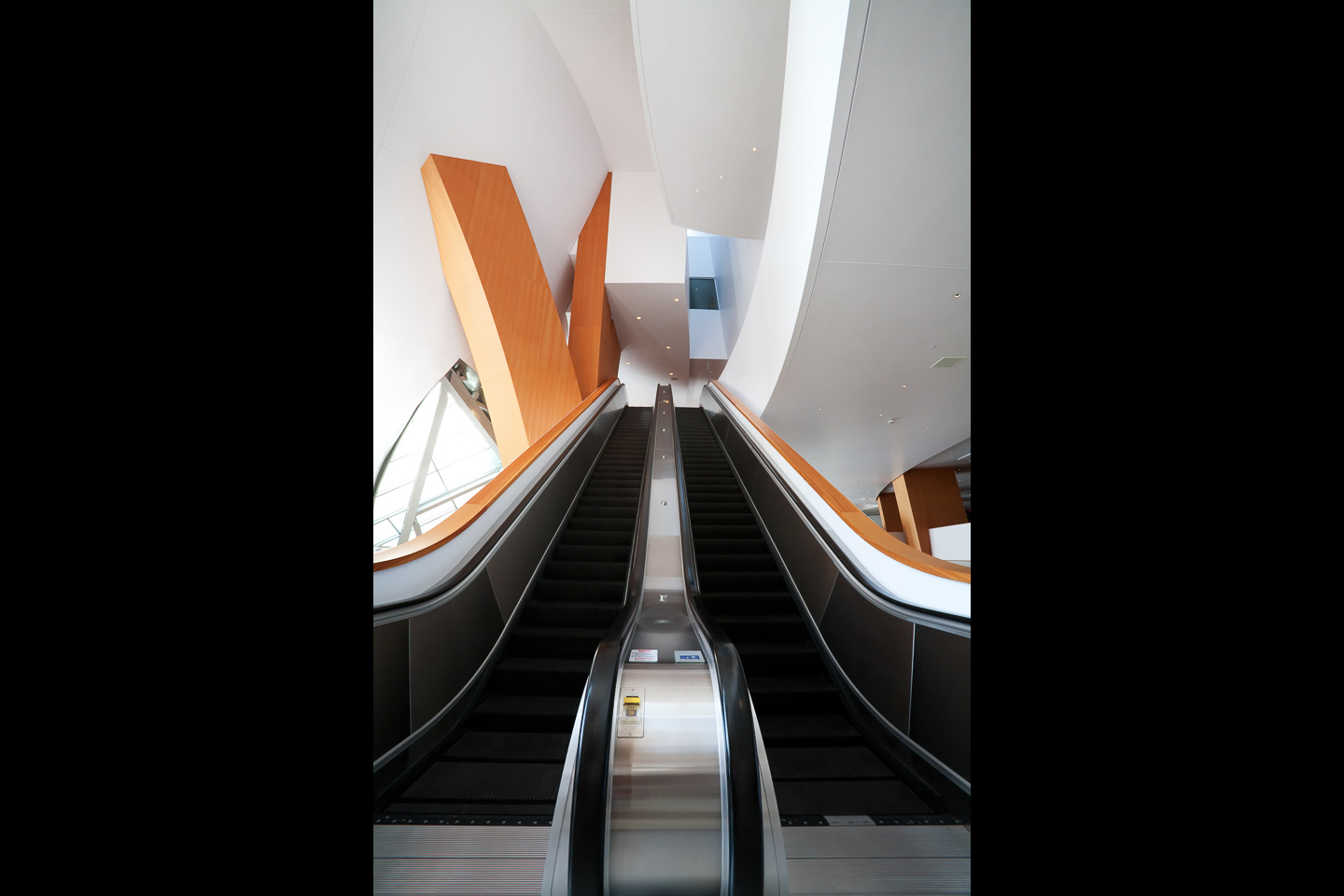 looking up the escalators inside the Walt Disney Concert Hall, designed by Frank Gehry, photographed by Jacob Rosenfeld