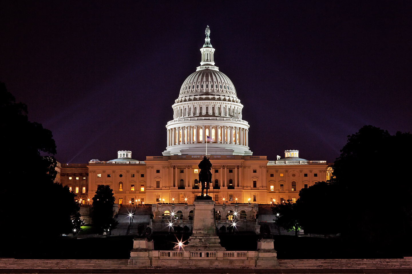 illuminated united states capitol building photographed at night by architectural photographer Jacob Rosenfeld