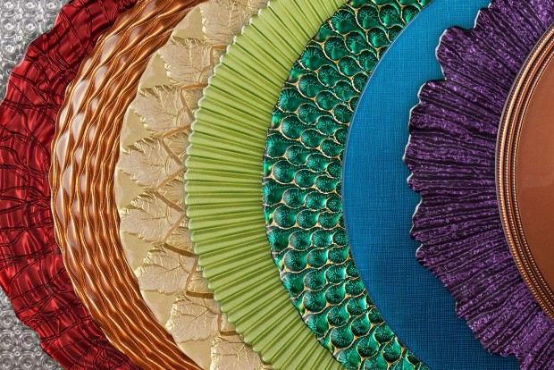 a montage of beautiful mandarin orange trading company charger plates, photographed by Jacob Rosenfeld