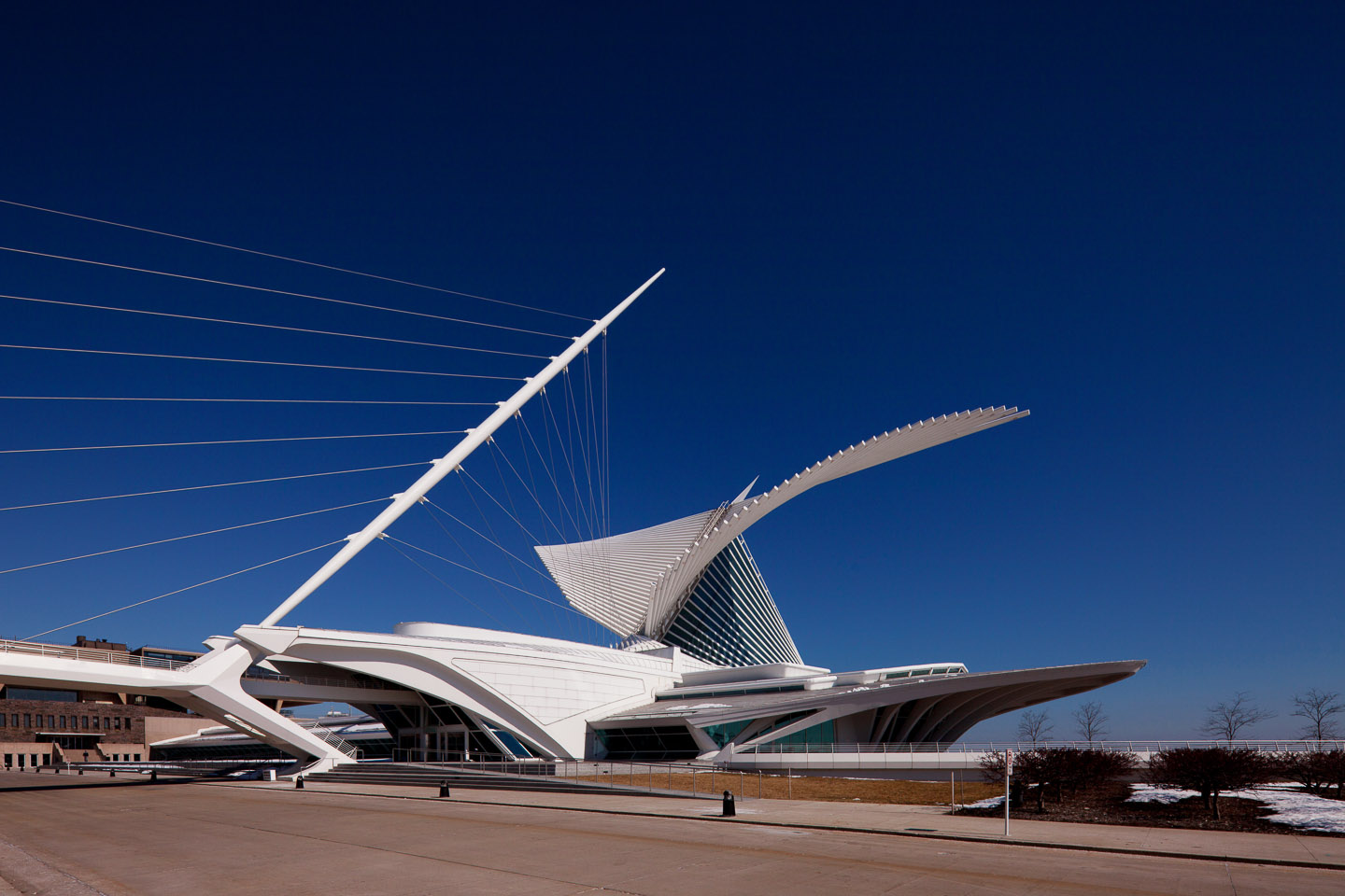 an exterior front corner close perspective of the Milwaukee Art Museum, desgined by Santiago Calatrava, photographed by Jacob Rosenfeld