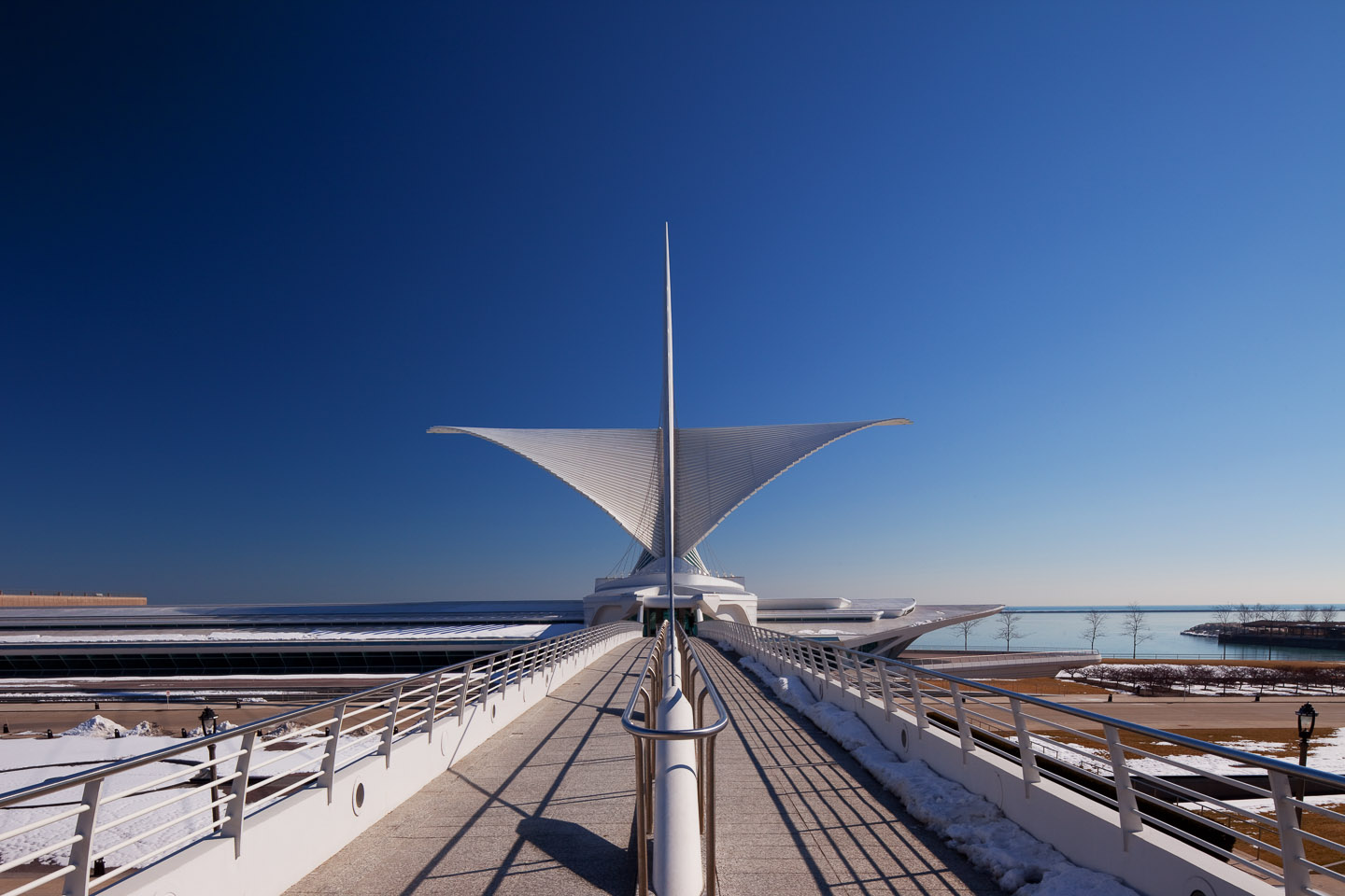 the exterior public entrance bridge for the Milwaukee Art Museum, designed by Santiago Calatrava, photographed by Jacob Rosenfeld