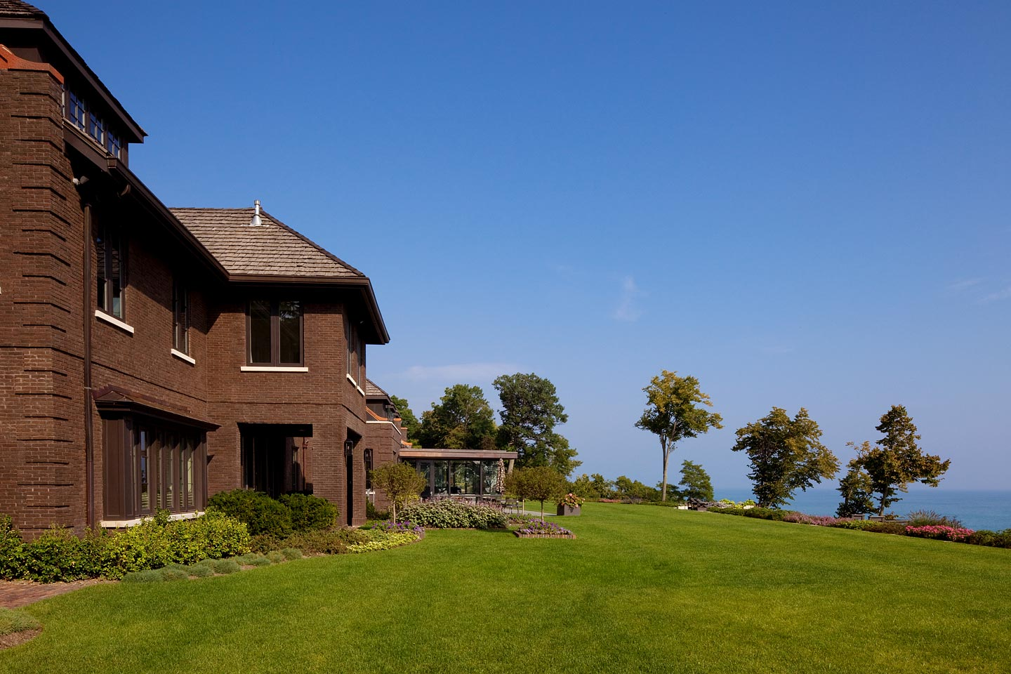 a rear exterior view revealing the juxtaposition of the house to Lake Michigan, photographed by Jacob Rosenfeld