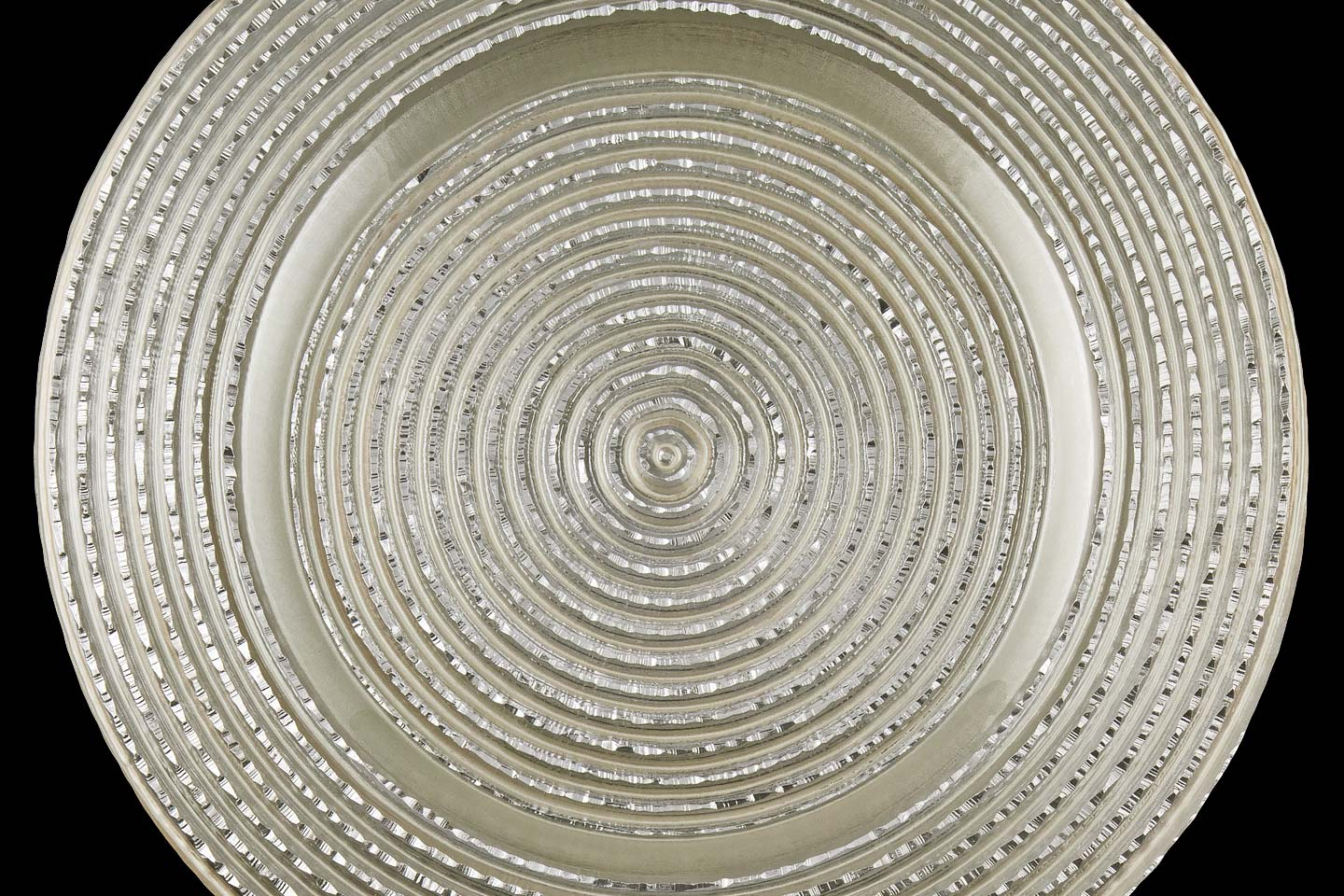 the silver pearl starlight charger plate from mandarin orange trading company, photographed by Jacob Rosenfeld