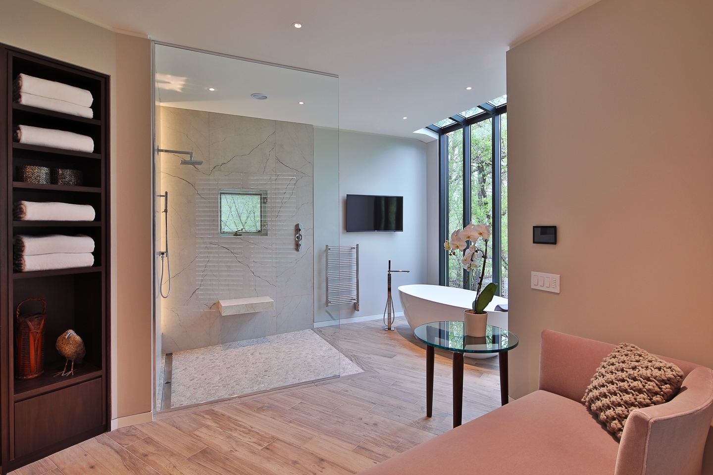 a nice sitting area at the central hub of the master bath suite, photographed by Jacob Rosenfeld