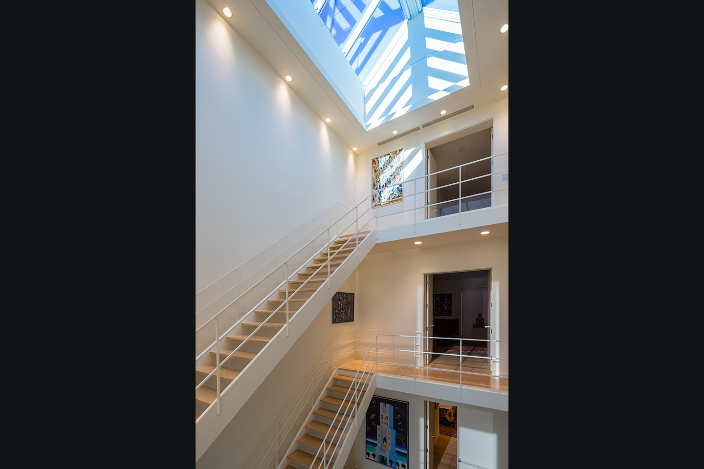 multi-story atrium featuring massive commercial skylight system 01, photographed by Jacob Rosenfeld Photography